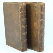 Two volumes of the Adventures of Robinson Crusoe by Daniel Defoe